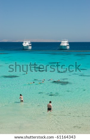 Snorkeling in a lagoon on a tropical island. Escape to a tropical paradise travel destination.