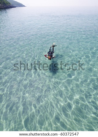 snorkeling in blue lagoon - stock photo