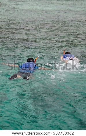 Snorkling. Two guys swimming in the ocean.