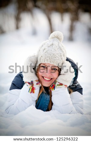 Snow and winter fun with young beautiful woman - stock photo
