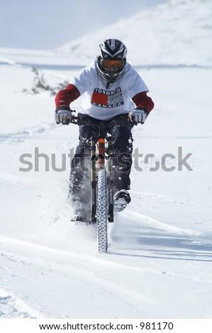 Snow biker downhill - stock photo