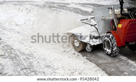 snow blowing machine in the street - stock photo