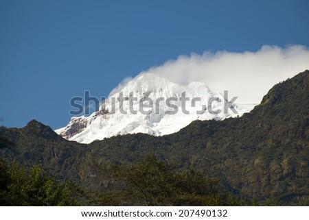 Snow-capped Antisana Volcano of the high Andes, Ecuador, South America - stock photo
