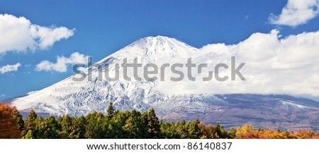 Snow capped Mount Fuji in autumn - stock photo