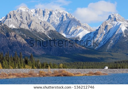 Snow capped Mount Wintour and Kananaskis lower lake in fall Alberta Canada - stock photo