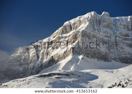snow capped mountain in winter at canadian rockies