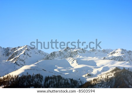 Snow capped mountains in the alps during winter. - stock photo