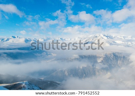 snow-capped peaks of the Alpine mountains against the blue sky
