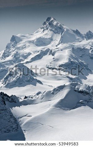 Snow covered beautiful mountain peaks - stock photo