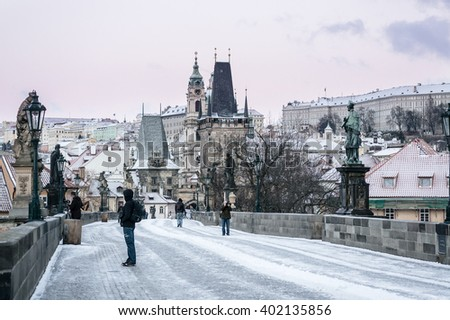 Snow covered Charles Bridge in Prague at dawn; Czech Republic - stock photo