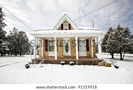 snow covered cottage in winter
