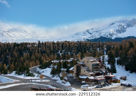 Snow-covered cottages at the French Alps in Devoluy - stock photo