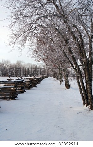 Snow Covered Fence Line - stock photo