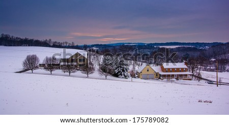 Snow covered fields and rolling hills in rural Carroll County, Maryland. - stock photo