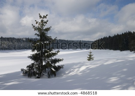 Snow covered frozen lake - stock photo