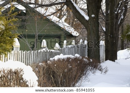 Snow Covered Garden And Barn - stock photo