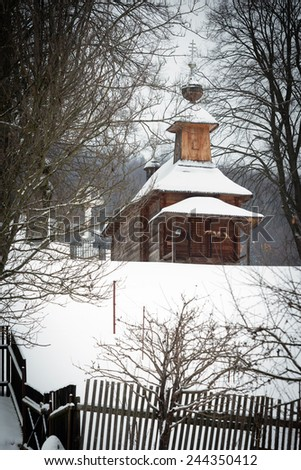 Snow covered Greek Catholic wooden church of St George the Great Martyr in Jalova, Slovakia