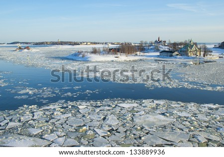 Snow covered islands in the icy Baltic sea (near Helsinki, Finland) - stock photo