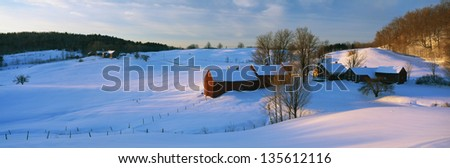Snow covered Jenne Farm at sunrise. - stock photo