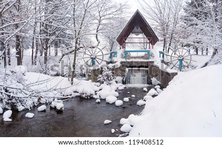 Snow-covered landscape in the city park - stock photo