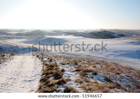 snow covered links golf course in ireland in winter - stock photo