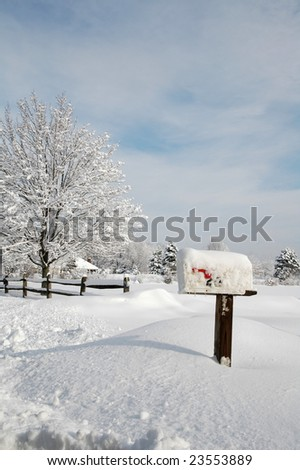 Snow covered mailbox against a cold New England winter landscape - stock photo