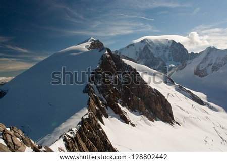 Snow covered mountain ridge at Mont Blanc massive - stock photo