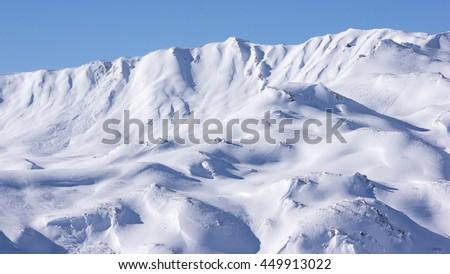 Snow covered mountain summits in the Austrian alps near Innsbruck, Tyrol, Austria. - stock photo