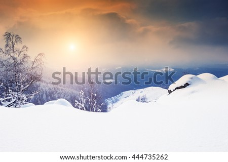 Snow covered mountains at sunset. Beautiful winter landscape.  - stock photo