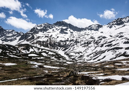 Snow covered mountains in the summer in the French alps - stock photo