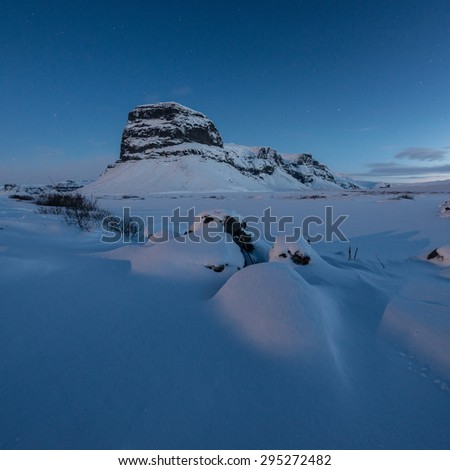 Snow covered of Lomagnupur mountain in Iceland - stock photo