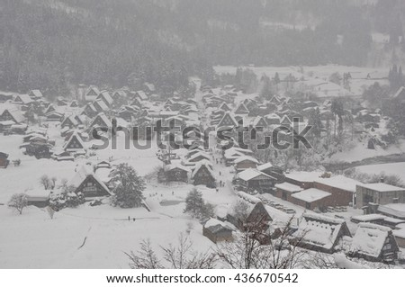 Snow covered old village in winter season - stock photo