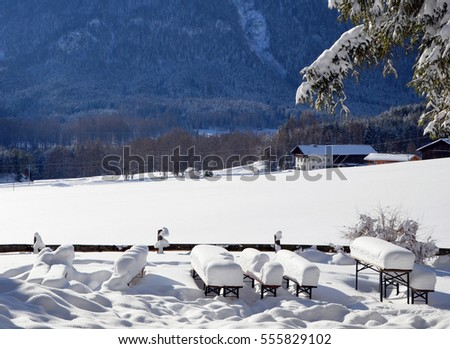 Snow-covered picknick tables, beautiful scenery in tyrol, austria