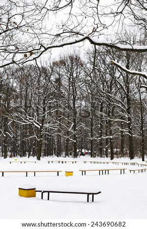 snow covered recreation ground in city park in winter - stock photo