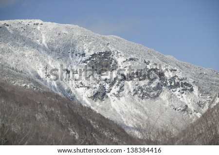 Snow covered rock faced wall on Mt. Mansfield, Stowe, Vermont, USA - stock photo