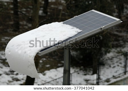 Snow covered solar panel  - stock photo