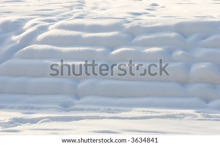 Snow covered staircase in park on winter sunset