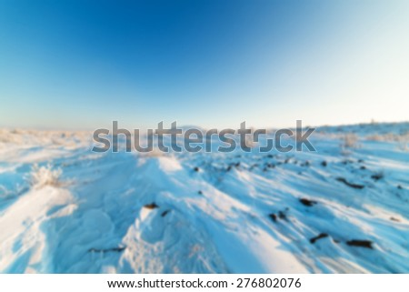 Snow-covered stone desert. Far North. Arctic. Abstract background blur deep. - stock photo