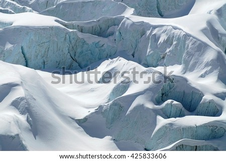 Snow covered the ice structures at the Fee Glacier in the Pennine Alps, Switzerland..