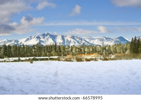 Snow covering mountain and trees in winter time at Lake Tahoe, California - stock photo