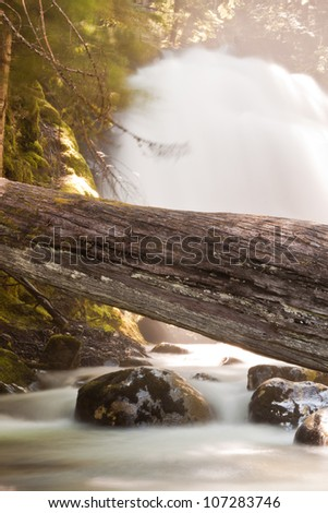 Snow Creek Falls Idaho,  upper falls early summer with a slow shutter and a full stream - stock photo