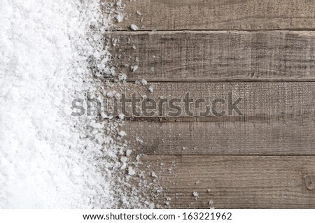 Snow drift on Wood Boards with Blank Space or Room for Copy, Text, or your Words.  Horizontal with cool, gray tones - stock photo