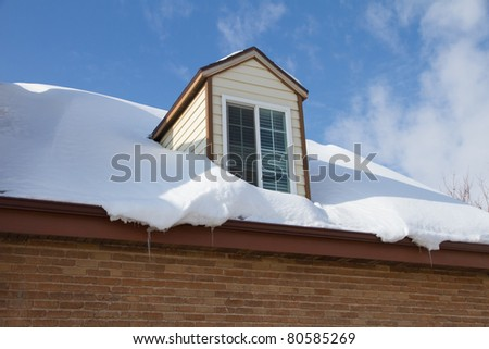 Snow drifted on roof of a home - stock photo