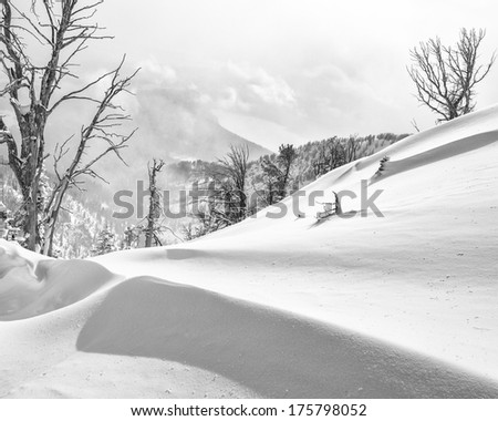 Snow drifts above Stewart's Draw.  Phelps lake is in the background. - stock photo