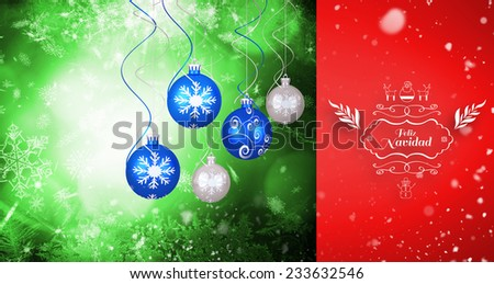 Snow falling against hanging christmas decorations - stock photo
