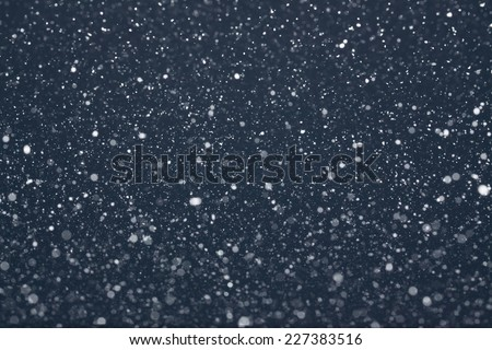 Snow Falling from Night Sky - stock photo