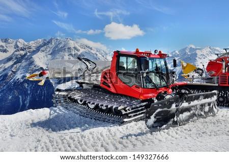 Snow groomer in Otztal Alps in Austria near Solden ski resort  - stock photo