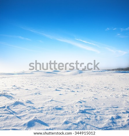 snow hill and blue sky - stock photo