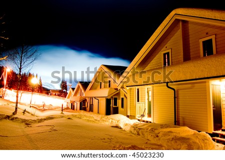 Snow houses in a row in ski resort, sweden - stock photo