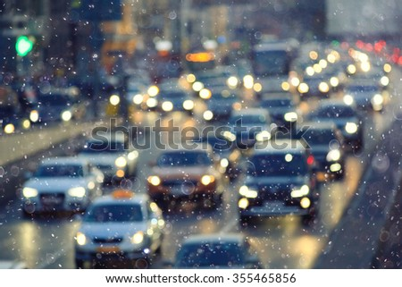 Snow in the city night traffic road transport
